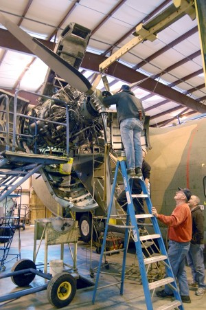 Greg, Jim and Lee reinstalling the prop on the C-123K